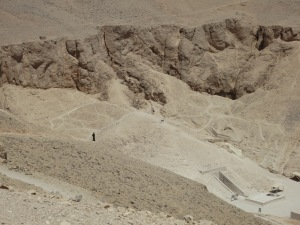 A lone black-robed hawker on a hill above the Valley of the Kings