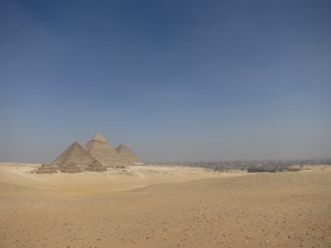 From front to back: the Pyramid of Menkaure with its three mini-pyramids, the Pyramid of Khafre, and the Great Pyramid of Giza