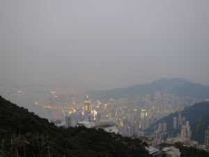 Hong Kong Central, seen from Victoria Peak on Hong Kong Island as the sun begins to set and the city starts to light up