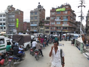 A regular traffic intersection in Kathmandu.  Complete with local dude nonchalantly picking his nose.