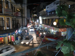 The streets of Thamel at night – chaotic wiring above, chaotic traffic below