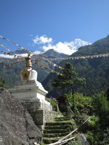 A stupa and Nepalese prayer flags on the trail on day two, on the way to Namche Bazaar
