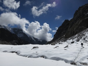 Crossing the snow-covered glacier after the Chola Pass