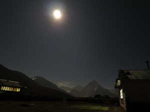 The night sky in Dzonghla, with a beautiful misty mountain backdrop dimly illuminated by the moonlight