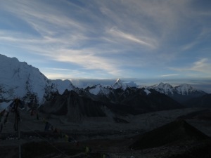 Looking down the Khumbu Valley from Kala Patthar as the sun begins to hit the snowy peaks