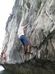 Doing a particularly poor job of deep-water soloing on one of the limestone karst islands in Lan Ha Bay