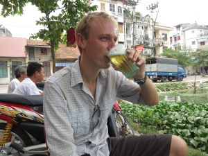 Enjoying a cold bia hoi during a hard day's sightseeing