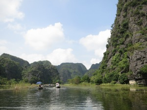 On our boat, rowing amidst the limestone karsts