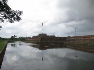 The walls, moat and flagpole of the ancient imperial city at Hue