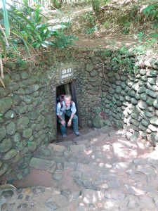 Standing/crouching in an entrance to the Vinh Moc Tunnels