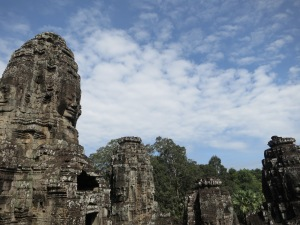 The faces of Bayon look out over the jungle that now inhabits Angkor Thom