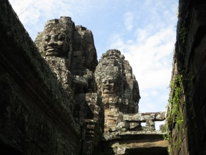Inside the Bayon, looking up to faces unperturbed by the passage of time and glory