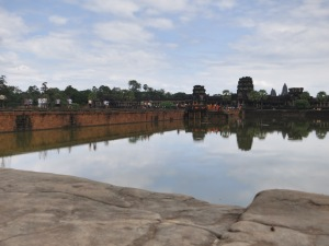 At the western entrance to Angkor Wat, looking across the moat