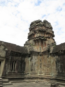A well-weathered stone pillar in Angkor Wat