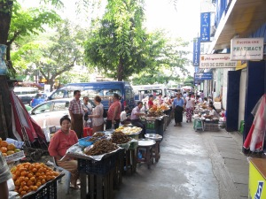 Street vendors in Yangon.  Those piles of brown things are crickets.  Tasty!