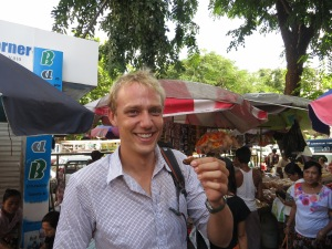 About to sample a tasty, tasty cricket, bought from a street seller in central Yangon