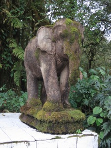 A moss-covered elephant statue forming part of the King Inthanon Memorial Shrine, at the summit of Doi Inthanon
