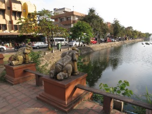 Statue elephants gaze along the moat that surrounds the square centre of Chiang Mai