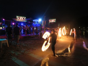 A slowly-building crowd enjoys the antics of the fire-stick twirlers on the beach at Slinky Bar in Loh Da Lum Bay on Ko Phi Phi Don