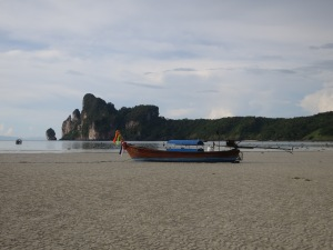 A longtail beached in Loh Da Lum Bay, Ko Phi Phi Don, at low tide