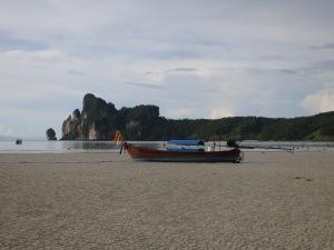 A longtail beached in Loh Da Lum Bay, Ko Phi Phi Don, at low tide