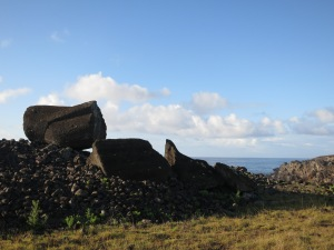 A moai lying broken on its ceremonial platform – this one Ahu Tetenga – near the shore