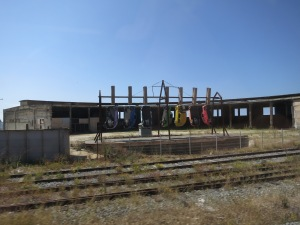 Installation art by the train tracks to Viña del Mar:  clothespegged Mini Minors