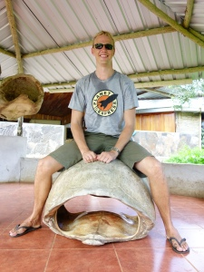 Riding a tortoise (shell) at Rancho Primicias.  Apparently sitting on a shell is hard work, because I appear to be covered in sweat.  Ewww.