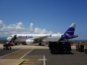 An AeroGal plane on the tarmac at Seymour Airport in the Galápagos