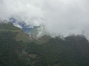 Machu Picchu literally in the clouds, seen from Putucusi Mountain