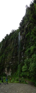 A waterfall falls directly onto the road on the Death Road