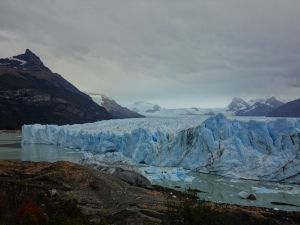 The face of Perito Moreno Glacier, forming a narrow channel between the glacier and the land edge of Lake Argentina