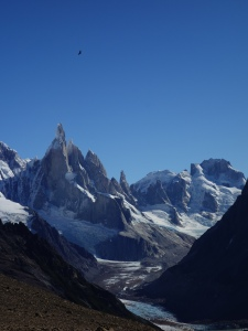 A condor flying high on an updraft over the mountains near El Chaltén