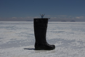 Chris falling into a boot, courtesy of the Uyuni salt flats