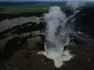 Devil's Throat as seen from a helicopter, generating its own clouds