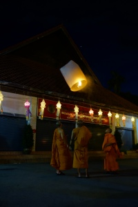 Young monks release a lantern for the famous Yee Peng festival in Chiang Mai